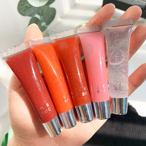 Pearlescent glistening lip gloss moisturizing transparent lip gloss