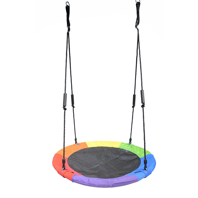Kids playing saucer fabric tree swing sets with rope