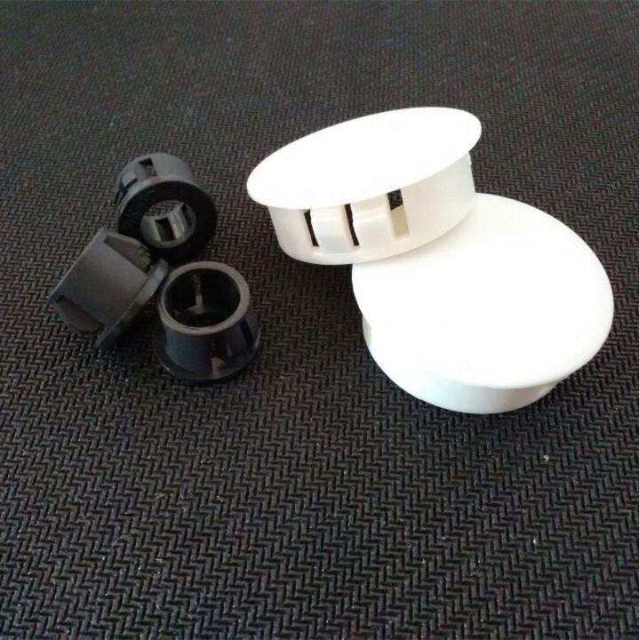 white plastic hole plugs