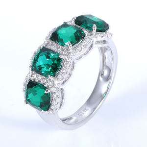 5x6mm elongate synthetic emerald 14k white gold engagement ring with melee moissanite stones paved around