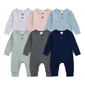 Wholesale bulk ribbed cotton baby jumpsuit solid colors fall newborn baby clothes