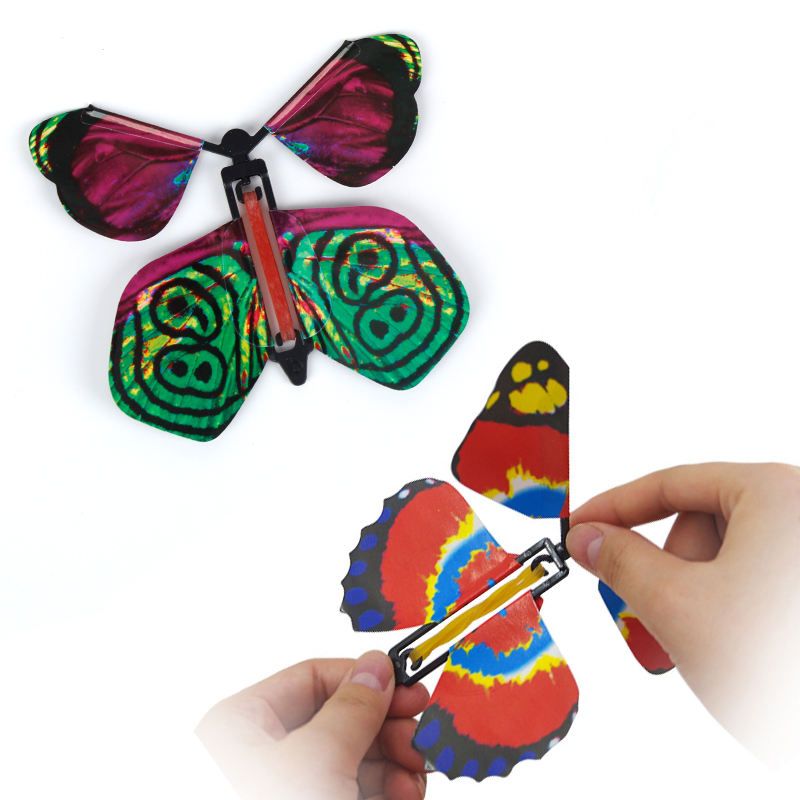 Artificial magic flying butterfly worked by elastic band tricks change hands funny prank joke mystical fun surprise gift toy