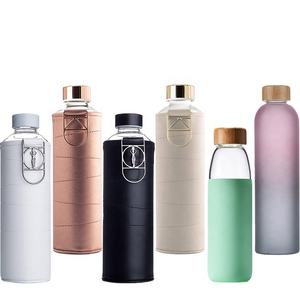 BPA Free Leak Proof Borosilicate Large Glass Water Bottle with Faux Leather Sleeve And Logo
