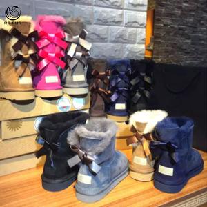 Wholesale fashion ladies sheepskin kids women winter snow ribbon fur boots with bows 2019