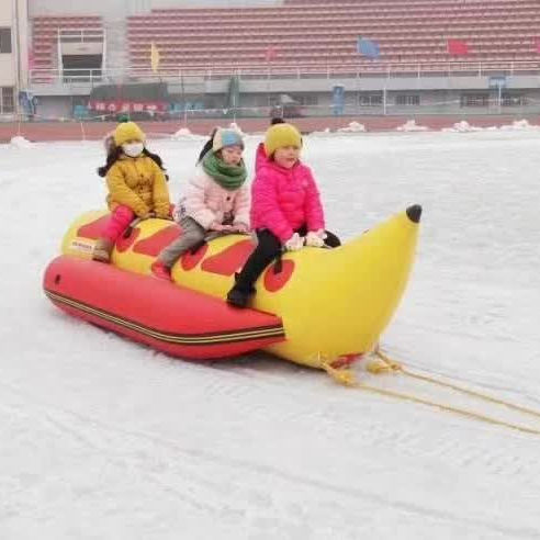 Amusement park and funfair park inflatable banana ski boats, inflatable banana boat for snow paradise in Winter