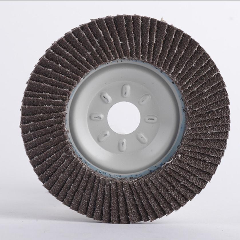 Machine making 100mm calcined alumina flap disc with 75mm metal backing pad