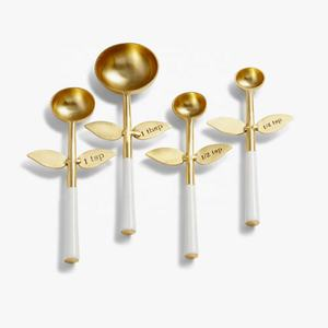 White Handle Gold Measuring Spoons