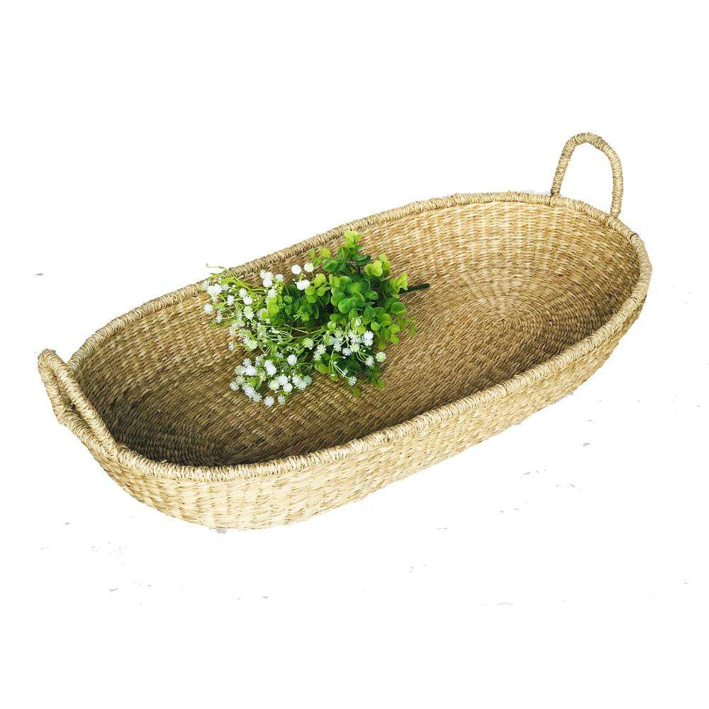Handmade baby changing basket made of natural seagrass