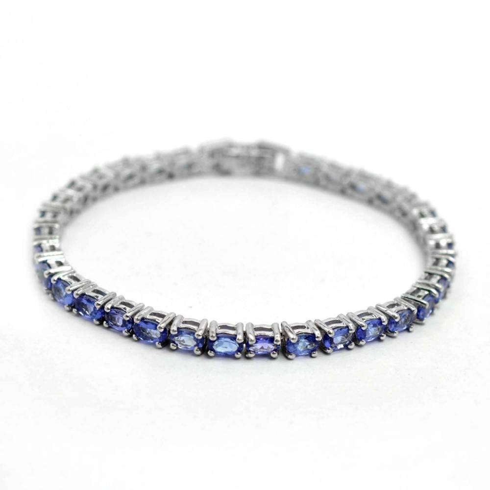 indian jewelry wholesale supplier of natural violet blue oval cut tanzanite 925 sterling silver tennis bracelet