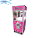 Pink claw machine coin operated arcade