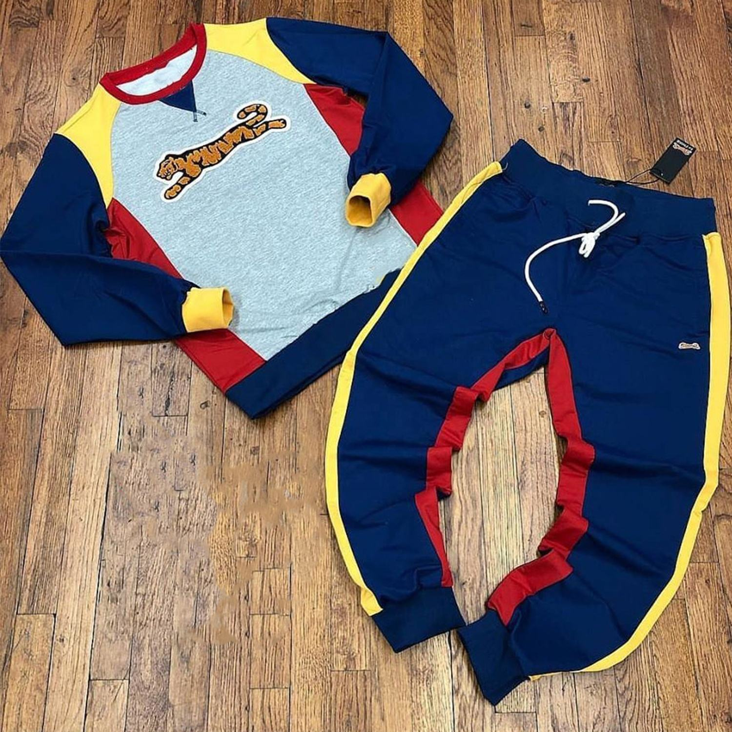 Wholesale Blank Track suits Design Your Own jogging Men Jogger Sweat suits with side stripes Made by Antom Enterprises