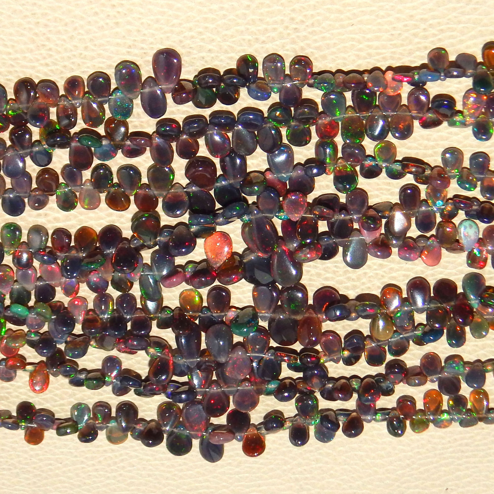 natural color play and fire smooth briolette beads ethiopian black opal beads