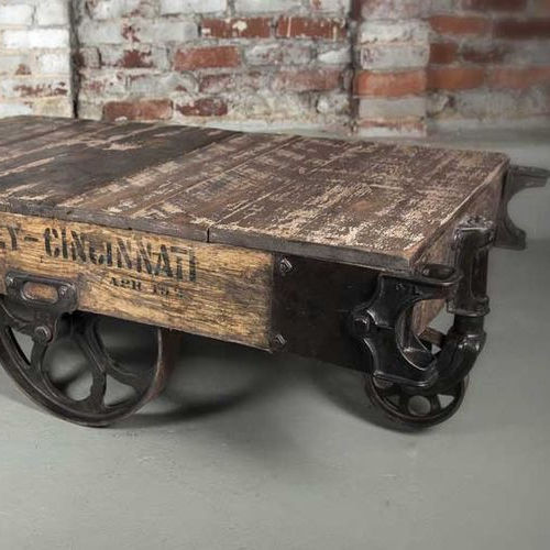 Vintage styled rustic aara finish industrial coffee table with castor wheels