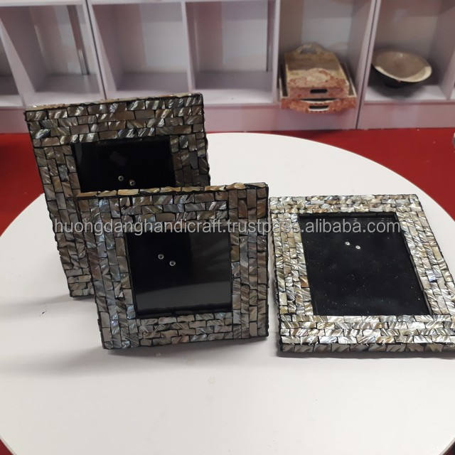 Lacquer photo frames with shiny seashell covered