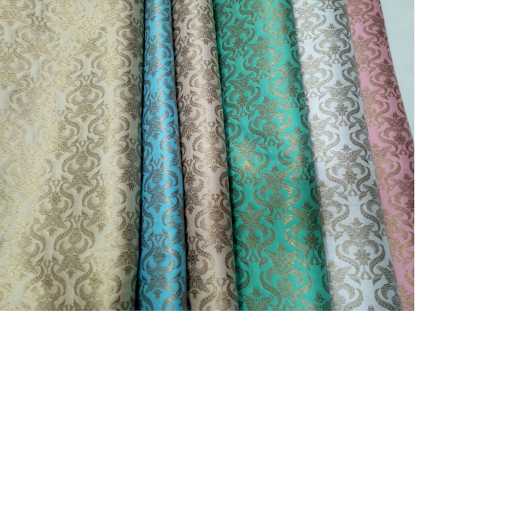 brocade silk fabric in a huge assortments of colour ways and patterns suitable for wedding dress designers and for home textile