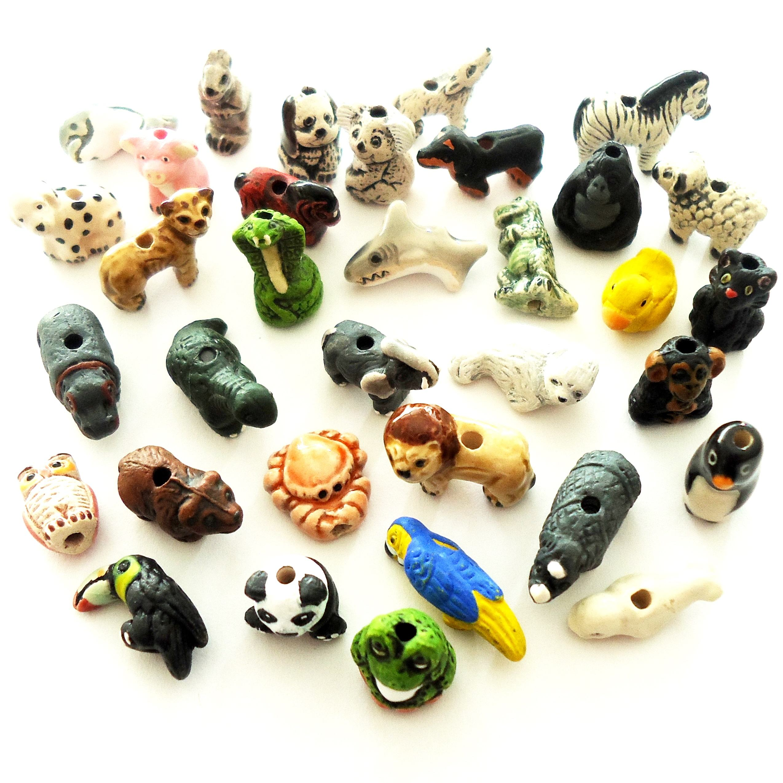 Wholesale Peruvian animal shaped ceramic beads for rosary and earrings making, Small animal shaped ceramic bead