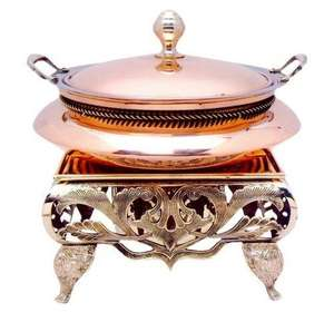 copper cheffing dis restaurant serving dishes indian chafing dish