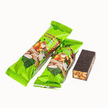 Roasted nuts in chocolate, delicious candy with nuts and chocolate