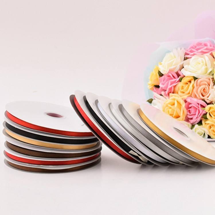 卸売シンプルなデザインの結婚式の装飾薄型プラスチック装飾リボンロール