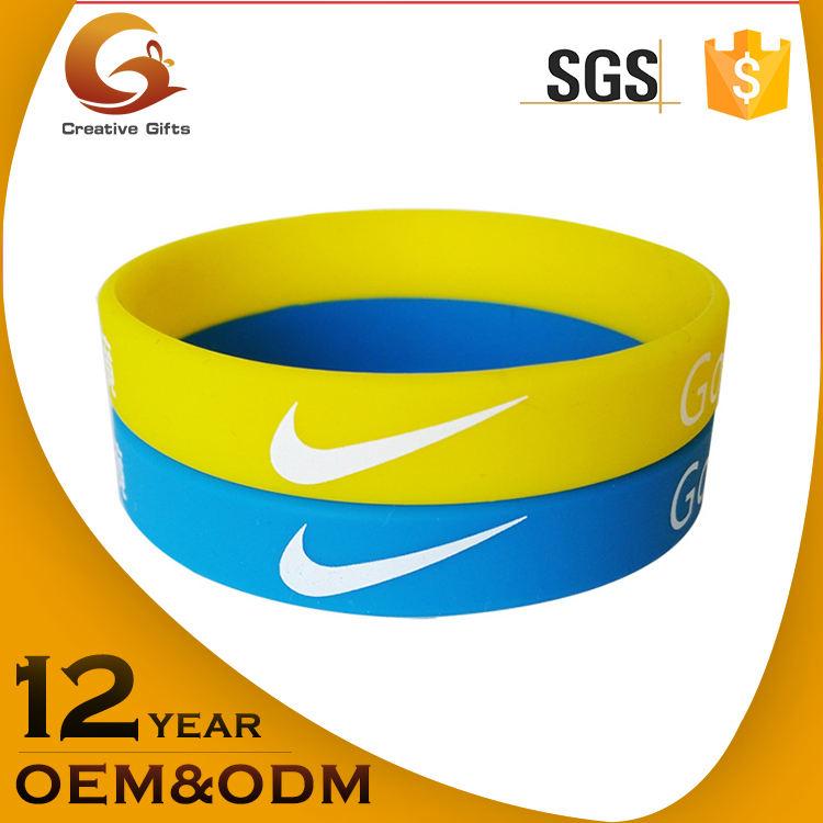 Promoción barato diseño personalizado ecológico Nike pulsera de silicona