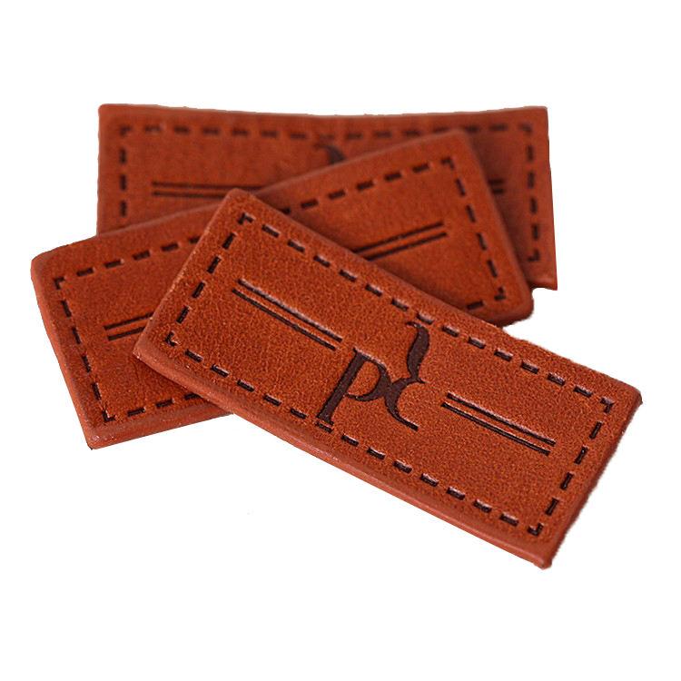Personalizado de marca privada diseño personalizado parche Jeans piel de vaca Etiqueta de parche de cuero