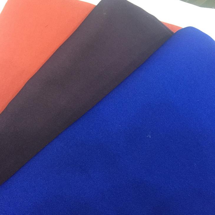 De alta calidad de sarga teñido de hilo negro azul naranja lona en general ropa de tela